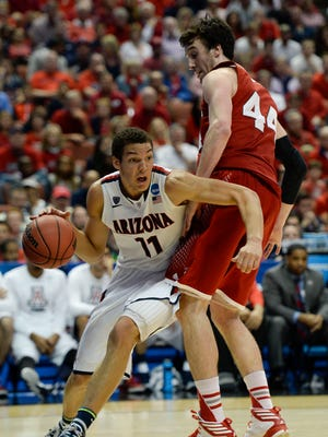 Mar 29, 2014: Arizona Wildcats forward Aaron Gordon (11) dribbles against Wisconsin Badgers forward Frank Kaminsky (44) during the second half in the finals of the west regional of the 2014 NCAA Mens Basketball Championship tournament at Honda Center.