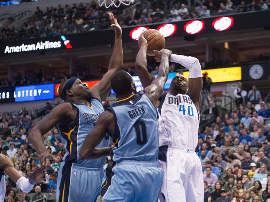 Memphis Grizzlies forward Zach Randolph (50) and forward JaMychal Green (0) defend against Dallas Mavericks forward Harrison Barnes (40) during the second quarter at the American Airlines Center on Friday, March 3, 2017.