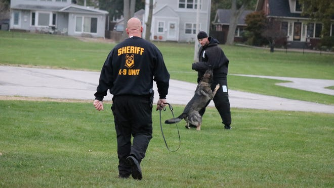 Cpl. Jeff Valentine, of the Franklin County Sheriff's Office, and his K9 partner Will perform an aggression control exercise during the evaluator course in Port Clinton.