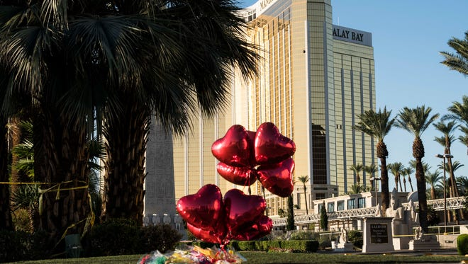 Las Vegas police block the streets near the Mandalay Bay hotel where some residents put balloons and flowers in  memory of victims on Oct. 2, 2017.