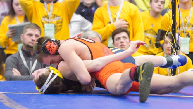A Brighton wrestling team that returned all-state talent like Eddie Homrock (top) added three transfers who have reached the podium at the state tournament.