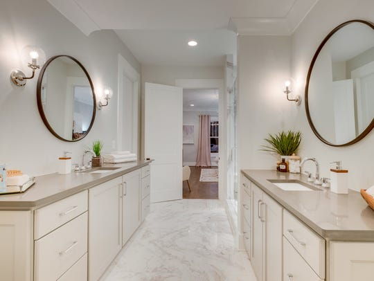 The master bath features marble design porcelain floors