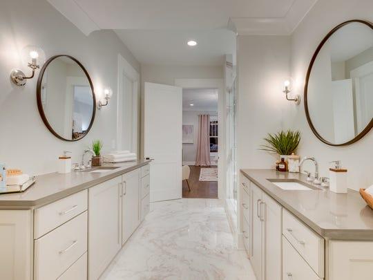 The master bath features marble design porcelain floors