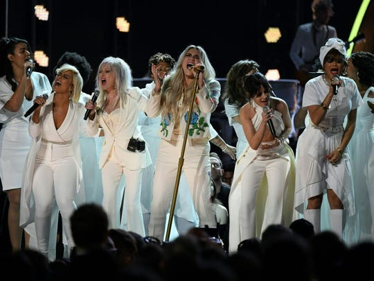 """Bebe Rexha (left, front row) performed """"Praying"""" with"""