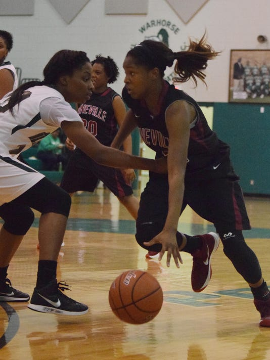 Pineville's Danyale Bayonne (42, right) takes the ball in against Peabody's Azia Reed (20, left) Tuesday.