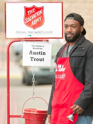 Boxer Austin Trout rings a bell while hosting a Salvation Army kettle on Tuesday in front of Walmart located on Walton Boulevard.