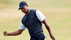 Tiger Woods reacts to his putt on the ninth green during