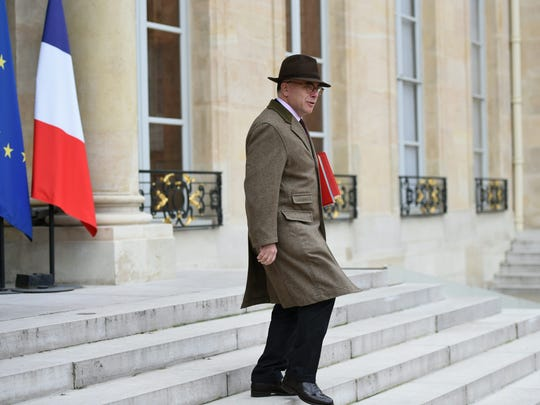French Interior Minister Bernard Cazaneuve leaves after attending the weekly government Cabinet meeting at the Elysee presidential palace in Paris on Dec. 2, 2015.