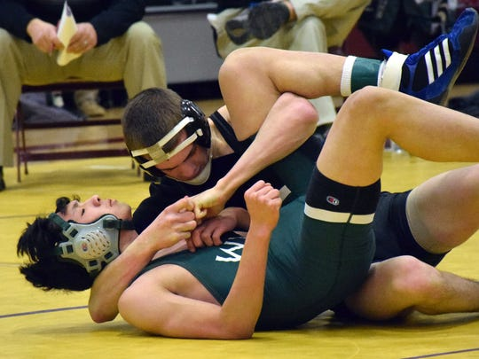 Buffalo Gap's Cullen Bendel, top, locks up the cradle on Wilson Memorial's Lee Bartosh during their 126-pound bout at the VHSL Conference 36 wrestling tournament on Saturday, Feb. 4, 2017, at Stuarts Draft High School in Stuarts Draft, Va.