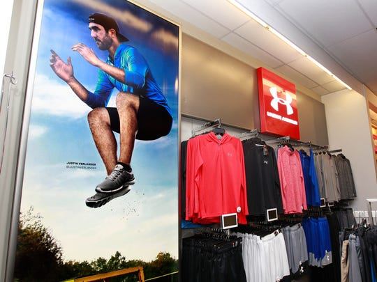 Kohl's CEO Kevin Mansell voiced optimism Thursday about the retailer's increased traffic in July. Among the steps Kohl's has taken to drive store traffic is greater emphasis on national brands, including Under Armour.