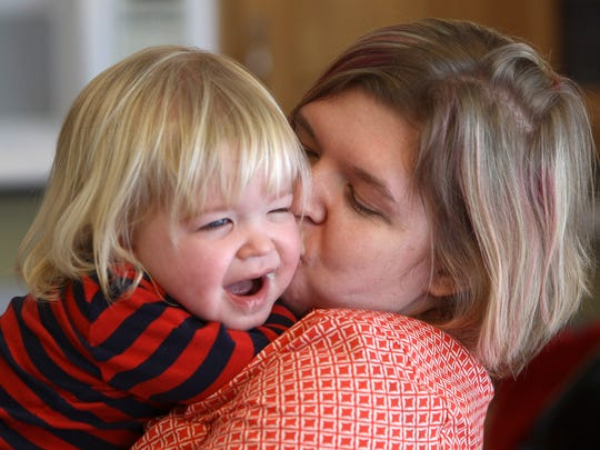 Crystal McGrew and her son, Amos, 2, at their home