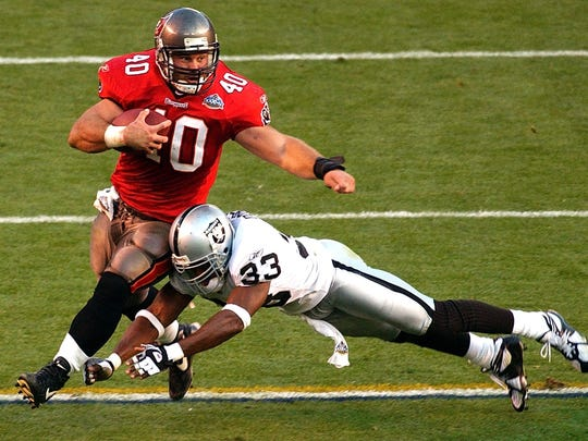 Tampa Bay's Mike Alstott (40) is tackled by Oakland's Anthony Dorsett (33) in the first half of Super Bowl XXXVII on Jan. 26, 2003.