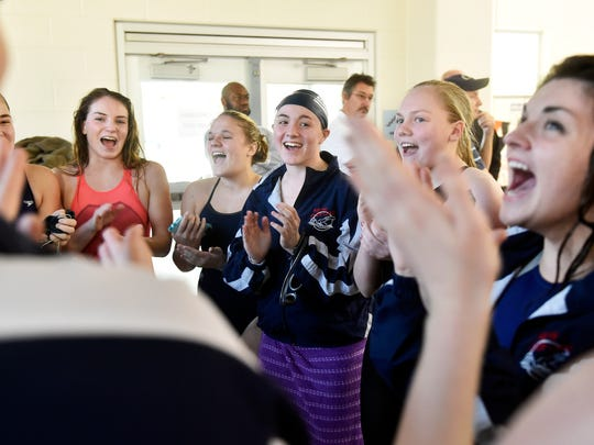 New Oxford swimmers cheer before beginning the YAIAA