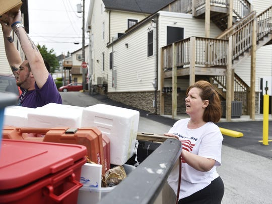 """Amy Edwards watches as her son Tyler Edwards packs the back of a truck on June 7, 2017, in Red Lion. Edwards' estranged husband Matthew Biondo has pleaded guilty or been found guilty of violating protection-from-abuse orders 14 times since 2007.  """"I don't think he's ever going to leave me alone,"""" Edwards said of Biondo, who has spent much of the last 10 years in York County Prison. """"I'm afraid all the time. I'm afraid of where I'm going to be moving to next. I'm afraid he's going to find it."""""""