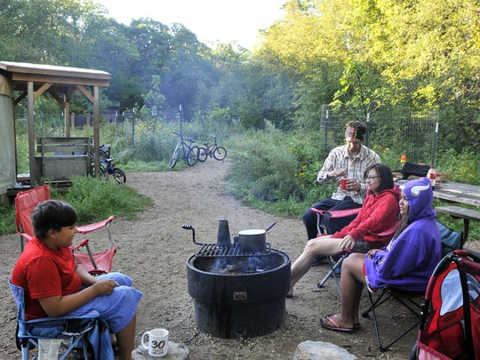 The David and Missy Sundheim family from Wadena started breakfast Aug. 17, 2016, outside the Eagle Yurt overlooking Annie Battle Lake in Glendalough State Park near Battle Lake.