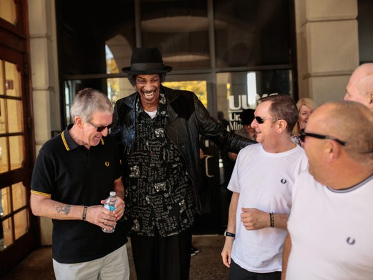 Singer Melvin Davis greets overseas fans at the St.