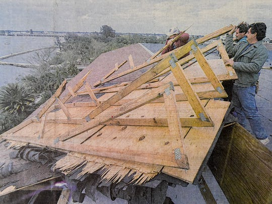 General contractors Wayne Strausbaugh, his son, Dewayne, and James Bryan match muscle with leverage to remove sections of roofing March 15, 1993, at the Edgewater Villas along the St. Lucie River in Stuart. The roofing was damaged during the superstorm that hit the Treasure Coast on March 13.
