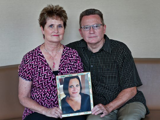 Julie and Daniel Rasmussen show a photo of their daughter Niki Rasmussen, Tuesday, June 27, 2018.  Niki died from a fentanyl overdose in Aug. 2017.