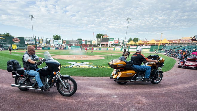 About 35 Harley riders circle around home plate after riding into PeoplesBank Park opening the game in York Saturday Sept. 3, 2016. The ride supports the Keystone Wounded Warriors.