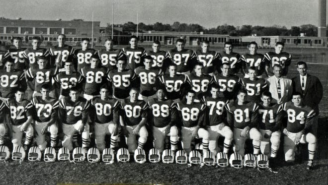 This is the 1958 Harding High School football team that won the United Press International Class AAA state championship. Team members are, front row from left, Gary Massie, Bob Wilson, Brent Sechrist, Ron Buckley, Tom Ruzzo, Ned Porter, Jim Miller, Gerald Bosh, Larry Ishida, Lee Williams, Vance Creviston, Ron Scott, Dave Rogers, Abner Thomas; middle row from left, coaches  Pete Sykes, Bob Simmons, Mike Chamberlain, Harl Evans, Bob Middleton, James Hathaway, Jim Maginn, John Lawson, Tom Prichard, Pete Poretis, Don Kern, coaches, and back row, from left, Bob Simpson, Joe Bolander, Phil Reid, Daniel Truex, Terry Hoffman, Ed Schoonmaker, Larry Weiser, Jerry Bechtle, Jim Kingsley, Dick Jeandrevin, Paul Huffman, Vaughn Kline, James Smalec and Marvin Cook. Assistant coach Matt Rock, who later became Harding's athletic director, recently died at the age of 85.