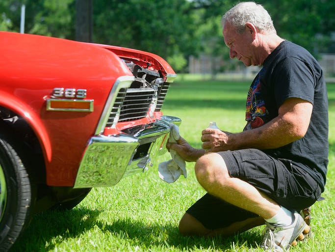 Tom Allen polishes the chrome on his 1972 Chevy Nova during the annual car and bike show in Autaugaville, Ala. on Saturday June 14, 2014.