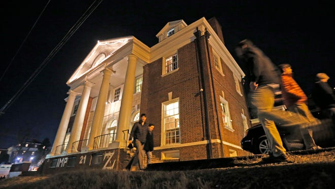 """This Jan. 15, 2015 file photo shows students participate in rush pass by the Phi Kappa Psi house at the University of Virginia in Charlottesville, Va. The house was depicted in a debunked Rolling Stone story as the site of a rape in September of 2012. A defamation trial against the magazine is set to begin on Monday, Oct. 17, 2016, over its article about """"Jackie"""" and her harrowing account of being gang raped in a fraternity initiation."""
