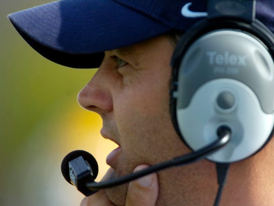 Augustana head coach Brad Salem watches from the sidelines as the Vikings beat Minnesota State University, Mankato 41-38 in overtime.(Elisha Page/Argus Leader)