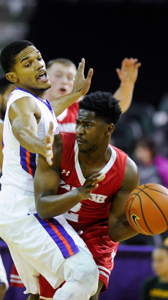 Evansville guard Duane Gibson (25) guards Wabash guard Ronald Ryan (2) during their game at the Ford Center in Evansville, Wednesday, Nov. 30, 2016. Evansville beat Wabash 83-39.