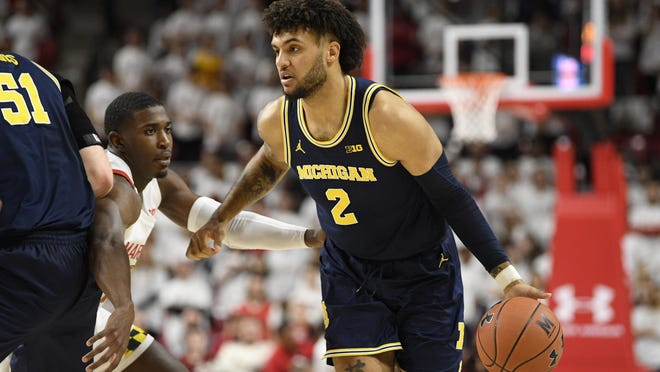 Michigan forward Isaiah Livers (2) dribbles the ball during the first half of an NCAA college basketball game against Maryland, Sunday, March 8, 2020, in College Park, Md.