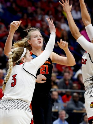 Louisville's Sam Fuehring (#3) and Arica Carter defend Oregon State's Marie Gulich. March 25, 2018