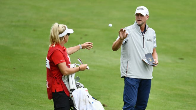 Steve Stricker catches his ball from his caddie and wife, Nicki, in the 18th fairway Friday at the American Family Insurance Championship at University Ridge in Madison.