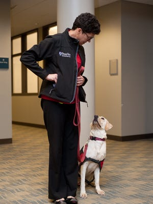 Dr. Cynthia Otto with Foster, an Ovarian Cancer Sniffing Dog in training from the Penn Vet Working Dog Center.