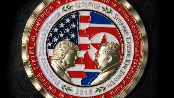 A coin for the upcoming US-North Korea summit is seen