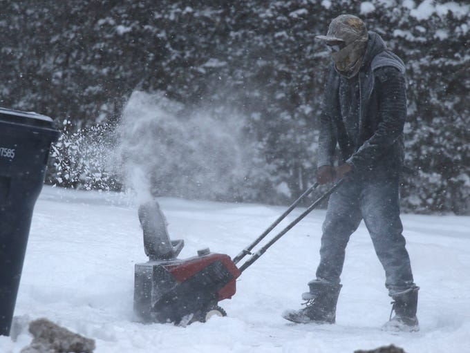 William Lundy of Irondequoit clears out his neighbor's