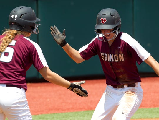 Vernon's Caroline Taylor, right, gets a high-five from
