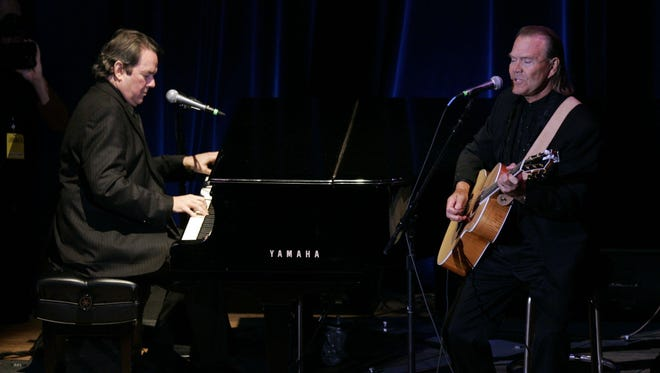 """Glen Campbell, right, and Jimmy Webb perform """"Wichita Lineman"""" at the 44th Annual ASCAP Music Awards Country at the Ryman Auditorium in 2006."""