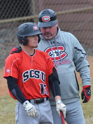St. Cloud State's Jordan Joseph (15) talks with coach Pat Dolan between pitches this season. Dolan and the Huskies are 36-14 and looking to win their third straight NSIC baseball tournament this weekend at the MAC.