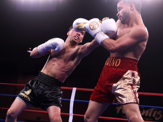 Santos Vasquez, left, takes on Bryan Aquino during