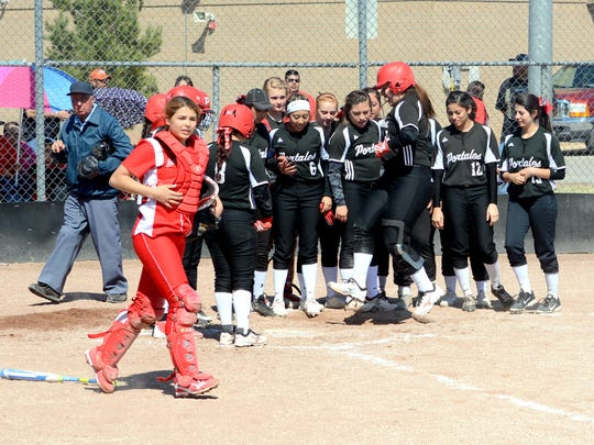 Portales welcomes Victoria Cordova at home plate after