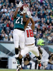 Atlanta Falcons' Taylor Gabriel, right, cannot make a catch as he is defended by Philadelphia Eagles' Leodis McKelvin during the second half Sunday, Nov. 13, 2016, in Philadelphia.