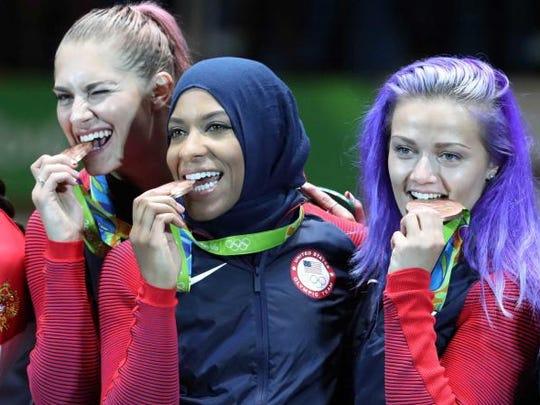 Monica Aksamit (far left) joins fellow New Jerseyans