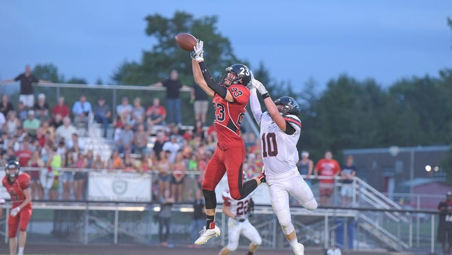 Pleasant senior defensive back Josh Warner defends a pass at Bucyrus on Friday night. The Spartans are 3-0 entering the Mid Ohio Athletic Conference portion of the season.