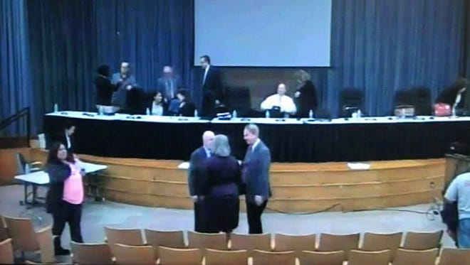 """A video, shown in this frame grab taken from a live feed of a recent Mahopac school board meeting, shows board President Raymond Cote, upper right, calling a woman """"chubby wubby."""" He resigned after some parents demanded he do so."""