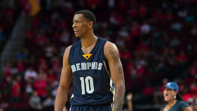 Memphis Grizzlies forward Troy Williams (10) celebrates his 3-point basket against the Houston Rockets during the second half at the Toyota Center.