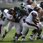 Michigan State's Malik McDowell pursues Central Michigan's Jahray Hayes during second half action on Saturda at Spartan Stadium in  East Lansing Michigan.
