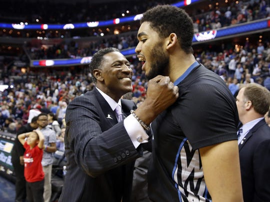 Minnesota Timberwolves coach Sam Mitchell, left, celebrates with center Karl-Anthony Towns after they defeated the Washington Wizards 132-129 in double overtime on March 25 in Washington.
