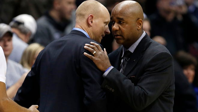 Xavier Musketeers head coach Chris Mack (left) shakes hands at the end of the game with the Georgetown Hoyas head coach John Thompson III at the Cintas Center in January of 2016.