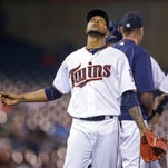 Minnesota Twins starting pitcher Ervin Santana leaves the game Thursday against the Miami Marlins in the seventh inning at Target Field in Minneapolis.