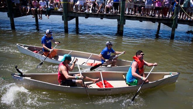 Racers in the Tippycanoe VIP Sprint Race collide at the finish line during the 41st annual Great Dock Canoe Race at the Naples City Dock at Crayton Cove.