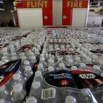 Thousands of water bottles are being handed out of the Flint Fire Station 3 in Flint on Thursday, Jan. 20, 2016.